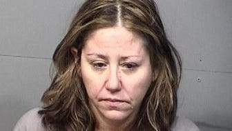 Nichole Nespolini, 40, of Melbourne, kicked an officer in the groin and peed on another officer, police say.