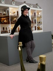 Jeni Jackson wears a tunic sweater and leggings from Soft Surroundings and a steam punk inspired hat by Callahan Chapeaux.