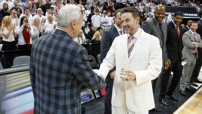 Louisville's Rick Pitino greets North Carolina's Roy Williams before the game. Jan. 31, 2015