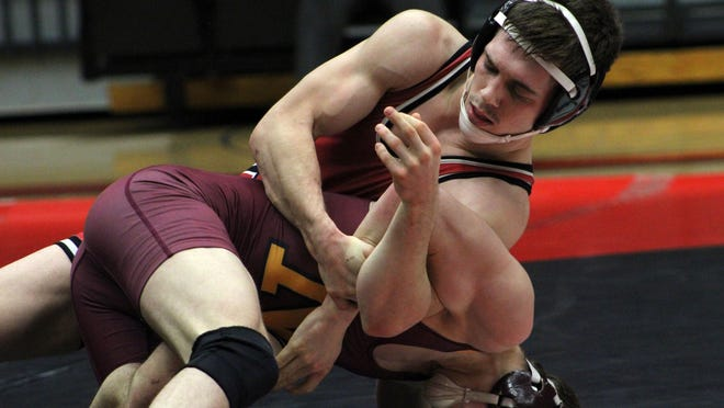 St. Cloud State's Brett Velasquez takes on Northern State's Matthew Leier at 125 pounds Saturday at Halenbeck Hall.