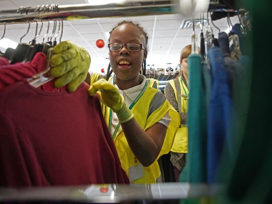 Nailah Henderson, 20, in 2016 learns how to color code inventory at Goodwill of Delaware while participating in the Goodworks program that helps prepare special needs high school students with barriers to employment.