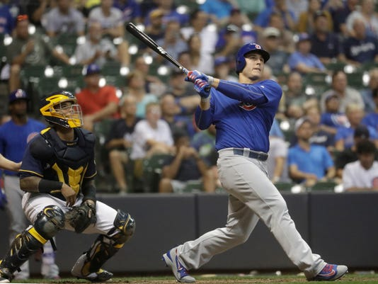 Chicago Cubs' Anthony Rizzo hits a two-run home run during the eighth inning of a baseball game against the Milwaukee Brewers Tuesday, Sept. 6, 2016, in Milwaukee. (AP Photo/Morry Gash)