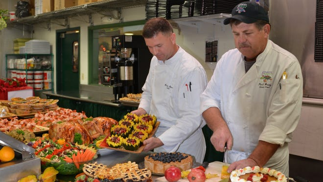 Executive chef Ercan Ekinci and sous chef Paul Brady of Green Turtle Market in Indian Harbour Beach prepare for Thanksgiving.