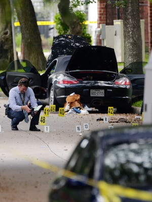 Police investigate the suspect's car after a shooting in Houston on Sept. 26, 2016.