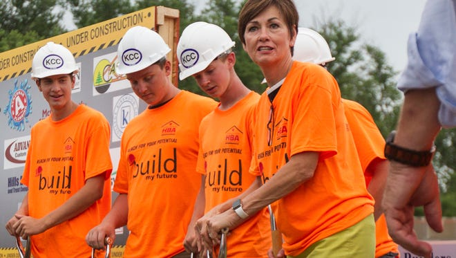 Iowa Gov. Kim Reynolds prepares to break ground with high school students from the Reach for your Potential group during a ground breaking ceremony for the Greater Iowa City Area Home Builders Association on Thursday, June 28, 2018. The build is being completed by eastern Iowa high school students who will gain college credit from their work on the project.