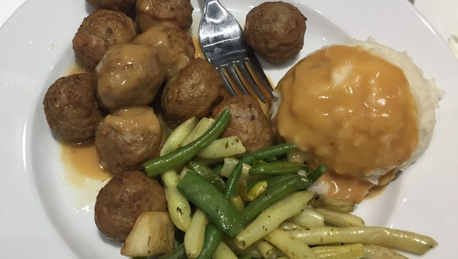 Ask for ligonberry jam and extra gravy when you order Swedish meatballs at Ikea. Dab some jam and a little bit of mashed potatoes on each bite of meatball.