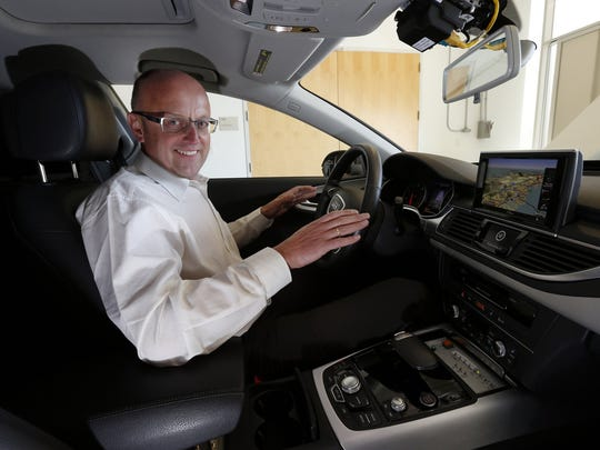 Ewald Goessmann, executive director at the Volkswagen Group Electronics Research Laboratory,  shows off an autonomous Audi A7 under development on March, 30, 2015, in Belmont, Calif.