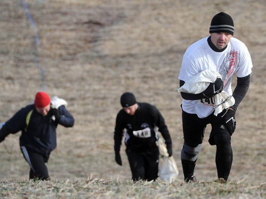 Maybe I'll even carry heavy things while I run up hills like these guys. Who knows? (File - Jason Plotkin - Daily Record/Sunday News)