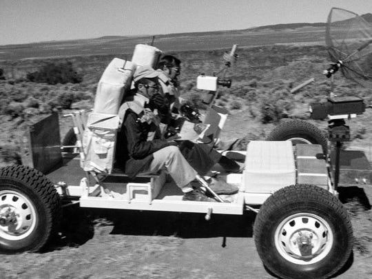 Apollo 17 astronauts Eugene Cernan, driving, and New