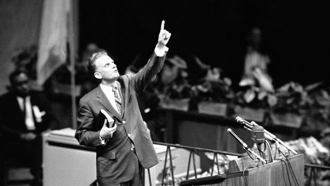 Evangelist Billy Graham is shown speaking at Madison Square Garden, New York City, May 15, 1957 as he opens a crusade.