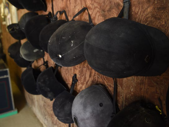 Riding helmets on display at the Crosswinds Equestrian