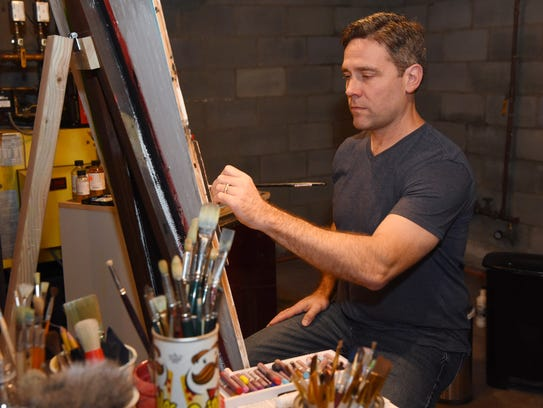 Thomas Cale paints in the basement of his Rhinebeck
