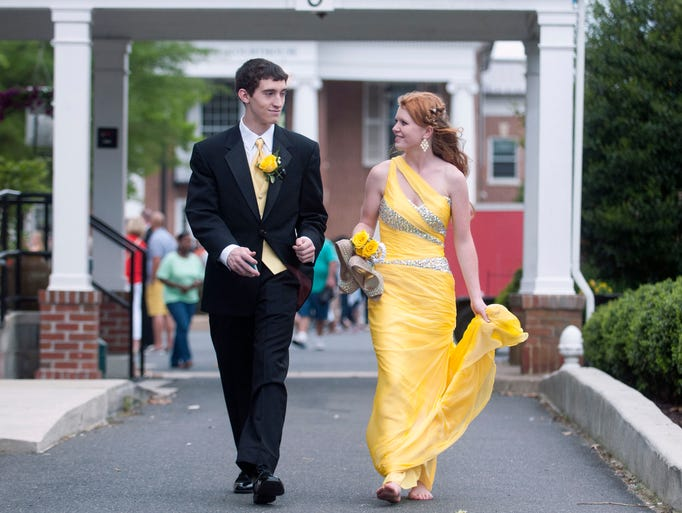 Sussex Central students Josh Shaffer and Courtney Betschner walk around downtown Georgetown before prom night.
