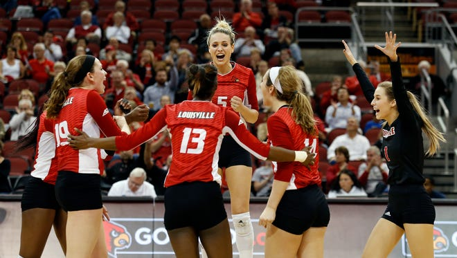 Louisville's Katie George (5), Molly Sauer (1) Roxanne McVey (14), Maya McClendon (13), Maggie DeJong (19) and Janelle Jenkins celebrate after the Cards score against Pittsburgh. Nov. 6, 2015