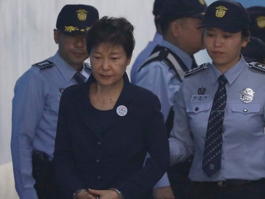 Former South Korean President Park Geun-hye, center,