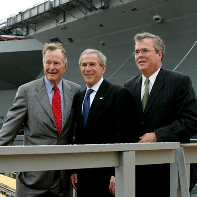George H.W. Bush, George W. Bush and Jeb Bush are seen in this 2006 photo.