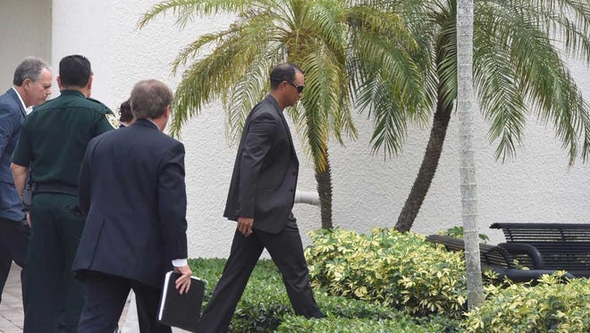 Tiger Woods shows up for his court hearing in Palm Beach Gardens Oct. 27, 2017.