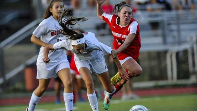 JEFF GRANIT/CORRESPONDENT Woodbridge?s Gabby D?Emilio (left) and Bishop Ahr?s Sarah Glawewski collide while pursuing the ball on Thursday in Woodbridge. Woodbridge's Gabby D'Emilio, left and Bishop Ahr's Sarah Glawewski collide going for the ball during their game in Woodbridge on Sept. 15, 2016.