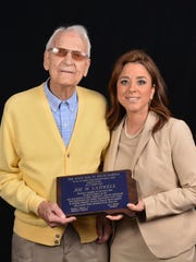 Attorney Joe Cadwell was honored Friday for his 75 years as a member of the State Bar of South Dakota. Helping honor him was his granddaughter Jennifer Van Anne, also an attorney.