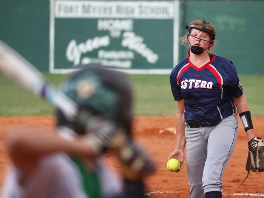 Estero's Alex Salter throws a pitch against Fort Myers during a Class 7A softball regional semifinal Tuesday night, May 8, 2018.