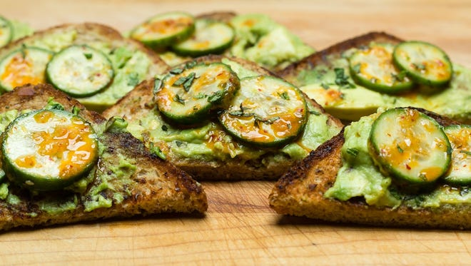 Avocado toast with kimchi-marinated cucumbers