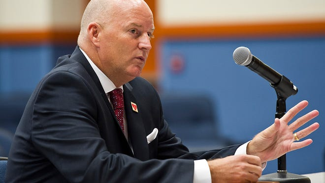 Mark Rendell, a candidate to become St. Lucie County's schools superintendent, answers questions from school board members in 2013 while being interviewed for the position.