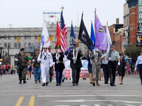 Members of the armed services honor guard march down Huron Avenue Monday, May 25, during the Memorial Day parade in Port Huron.