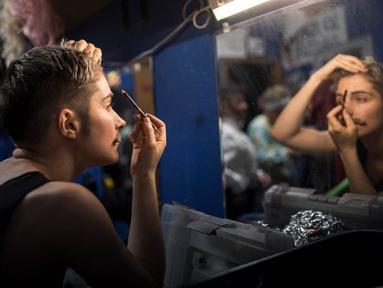 Lauren Pass applies her final touches as the delicate