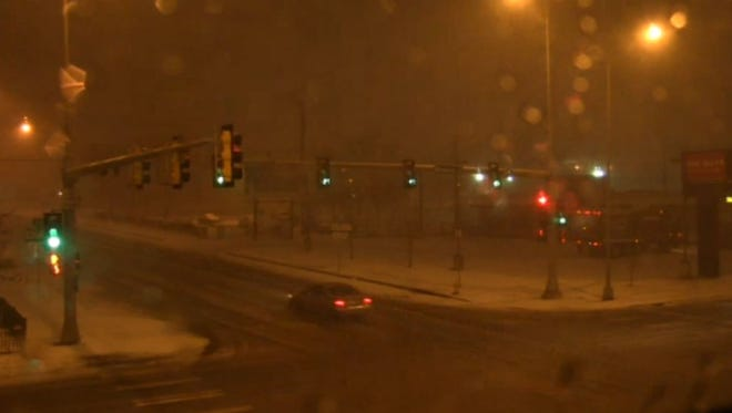 Snow falls in downtown Sioux Falls on Thursday morning.