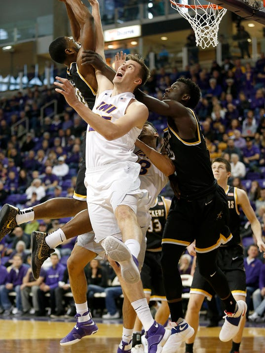 Northern Iowa's Bennett Koch fights for a rebound against Wichita State's Rashard Kelly and Eric Hamilton, right, during the first half of an NCAA college basketball game in Cedar Falls, Iowa, Sunday Jan. 8, 2017. (Brandon Pollock/The Courier via AP)