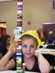 Licking Heights third-grader Bethany Steele poses with her entry in the Block Kids Building Competition.