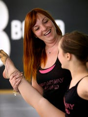 Lindsay Williams works with Molly Wilson, 11, of Toms River at the Toms River dance studio she opened in 2011.