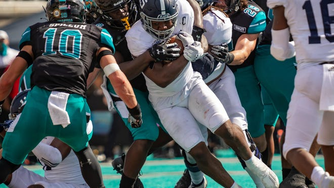 Georgia Southern senior running back J.D. King runs for some tough yards against host Coastal Carolina on Saturday in Conway, S.C.