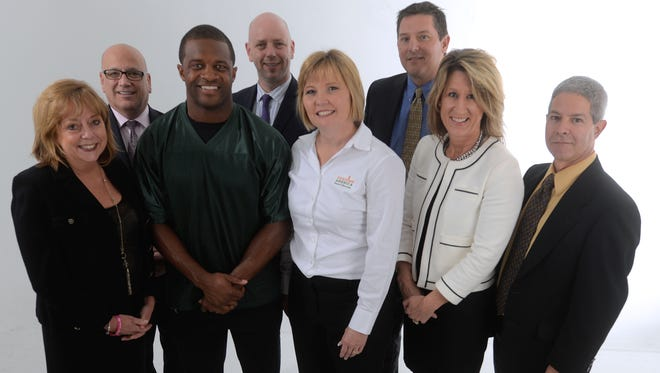 Randall Cobb with the Gannett Wisconsin Media leadership team and executives from Feeding America Eastern Wisconsin to kick off the Stock the Shelves 2015 campaign. From left, Pamela Henson, president and publisher of the Post-Crescent of Appleton, Oshkosh Northwestern and Reporter of Fond du Lac and Regional President of Gannett Wisconsin Media, Thomas Baylerian, vice president of advertising, Gannett Wisconsin Media, Randall Cobb, Joel Christopher, vice president of news, Gannett Wisconsin Media, Patti Habeck Executive Vice President Feeding America Eastern Wisconsin, Scott Johnson, president and publisher Green Bay Press Gazette , Laurie Bolle, general manager Gannett Central Wisconsin Media, Robert Zizzo, news director Green Bay Press-Gazette.