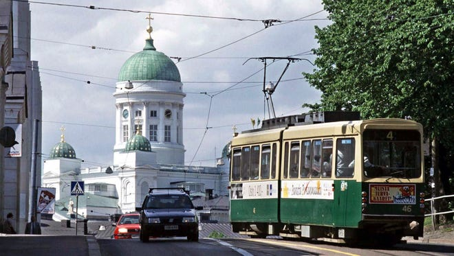 City traffic passes the Lutheran cathedral in Helsinki, Finland. Lose your wallet in this capital and you are most likely to have it returned to you, according to a recent Reader's Digest test of honesty.