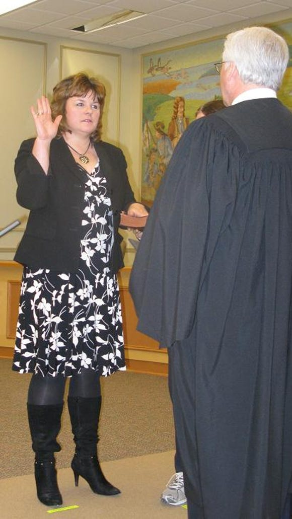 Paula Metzler (Town Council) is sworn in by the Honorable James P. Mulley, Jr.