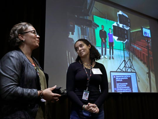 Makeeba McCreary, left, chief of learning and community engagement for Boston's Museum of Fine Arts, and student actor Jennifer Rosa present a video describing a new protocol for student group visits at the museum, Oct. 2 in Boston.