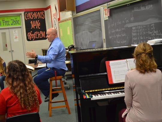 Oak Harbor High School choir director Russ Exlos-Raber