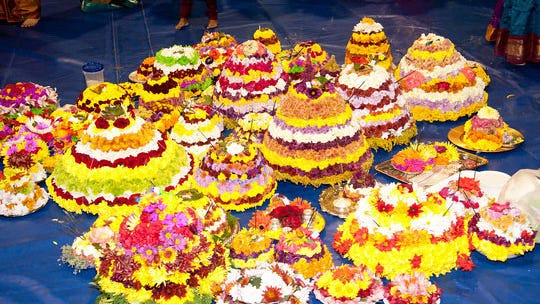 Bathukamma is a spring festival celebrated mostly by young Hindu women of Telangana in India, who prepare floral arrangements (bathukamma) as the embodiment of the goddess Gauri, the goddess of womanhood.