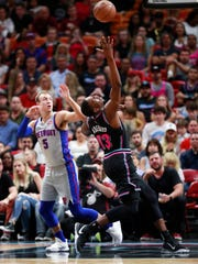 Miami Heat center Bam Adebayo (13) loses control of the ball as he goes up to shoot against Detroit Pistons guard Luke Kennard (5) during the first half of an NBA basketball game, Saturday, Feb. 23, 2019, in Miami. (AP Photo/Wilfredo Lee)