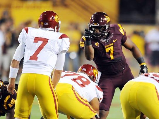 ASU's Vontaze Burfict gestures at USC quarterback Matt
