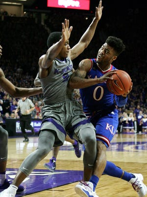 Kansas guard Frank Mason III (0) controls the ball as Kansas State guard Barry Brown (5) defends during the second half at Fred Bramlage Coliseum. The Jayhawks won 74-71.