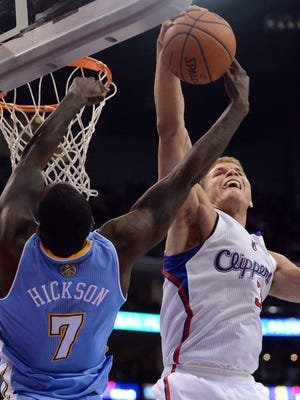 Blake Griffin, right, blocks a shot attempt by J.J. Hickson.