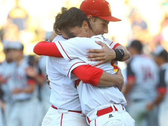 Palm Desert High School's Anthony Boetto and Izayah Alvarez hug after losing the CIF Division 2 championship game against Etiwanda High School at Dodger Stadium on June 2, 2017. Etiwanda won 2-1.