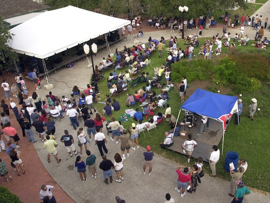 In 2012 crowds begins to gather at Heritage park under one tent where jazz festival performers begin to play music.