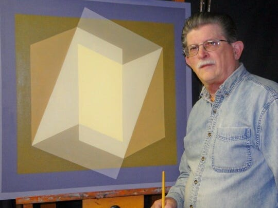 Artist David John Rush is at his easel with his contemporary