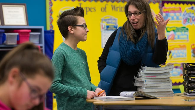 Teacher Sabrina Holden (right) helps seventh grade student Jack Feider with a science question at Chilton Area Catholic Schools in February.