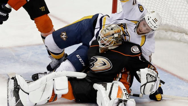 Predators center Colton Sissons falls onto Ducks goalie Jonathan Bernier during the second period of Game 5 on Saturday.