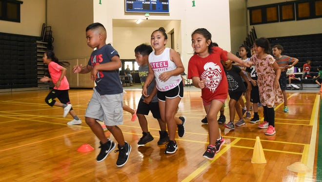 "Children play ""Roadrunner"" at the University of Guam Adventure Sports Camp at the Calvo Field House in this July 2, 2018, file photo."