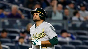 Oakland Athletics Coco Crisp heads home on his seventh-inning solo home run against the New York Yankees on Thursday.